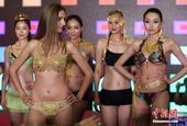 靓丽的模特、耀眼的黄金内衣……近日,一场以黄金为主题的时尚秀在南京国际会议中心上演,轮番登场的模特精...