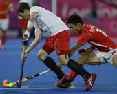 高清图:男子曲棍球比利时胜韩国 比赛场面激烈