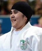 高清:沙特首派奥运女运动员 黑纱覆发虽败犹荣
