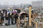 日本宫城县民众纪念地震一周年