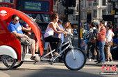 伦敦奥运会开幕在即,伦敦闹市街头出现各类奥运印迹的同时,奥运话题更直接或间接地呈现在街头各色人等身上...