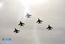 """""""和平使命2014"""":中方空军多型战机挂弹起飞"""