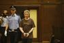 北京动物园原副园长受审 面带微笑