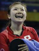 运动员的笑容。